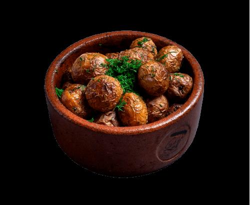 Обсмажена молода картопля з зеленню
